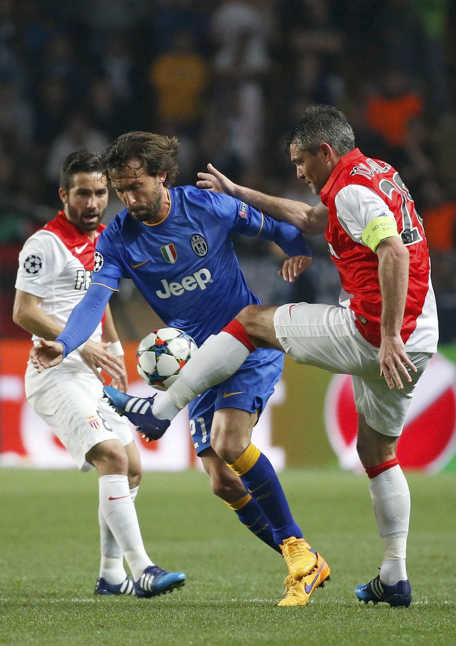 Monaco's Moutinho and Toulalan challenge Juventus Pirlo during their quarter-final second leg Champions League soccer match at the Louis II stadium in Monaco