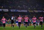Juventus' team celebrate at the end of the Italian Serie A football match Sampdoria vs Juventus on January 10, 2016 at 'Luigi Ferraris Stadium' in Genoa. / AFP / MARCO BERTORELLO        (Photo credit should read MARCO BERTORELLO/AFP/Getty Images)