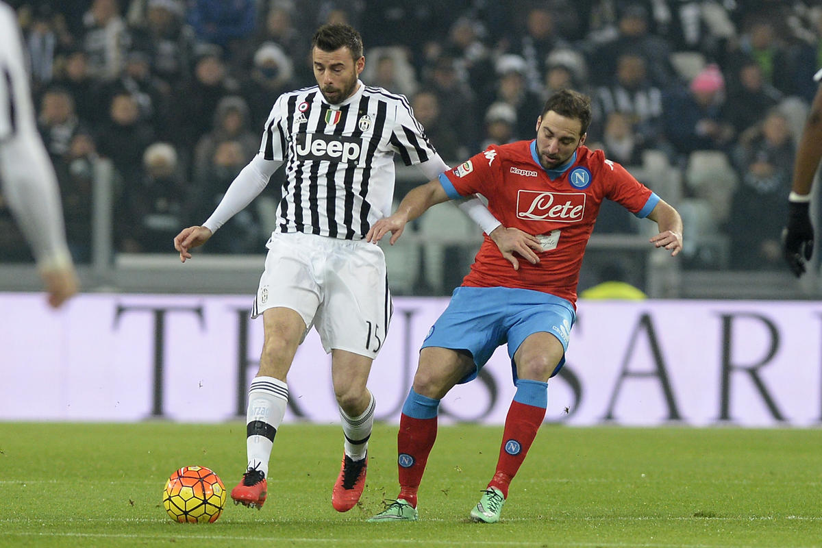 Juventus' Andrea Barzagli challenges the ball with Napoli's Gonzalo HIguain during a Serie A soccer match between Juventus and Napoli at the Juventus stadium, in Turin, Italy, Saturday, Feb. 13, 2016. (AP Photo/Massimo Pinca)