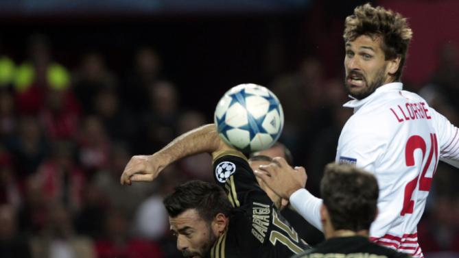 Sevilla's Fernando Llorente, right, is airborne with Juventus' Andrea Barzagli, center, during the Champions League Group D soccer match between Sevilla and Juventus, Ramon Sanchez-Pizjuan stadium in Seville, Spain, Tuesday, Dec. 8, 2015. (AP Photo/Miguel Angel Morenatti)